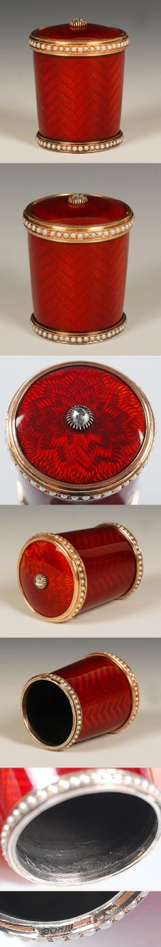 A Faberge jeweled, gold and guilloche enamel parasol handle, workmaster Michael Perchin, ST Petersburg, circa 1899-1903, with scratched inventory number 6923. Slightly tapering cylindrical form, enameled overall in scarlet red over engine turned ground. The top and bottom borders are set with pearls and the terminal is set with a rose cut diamond.