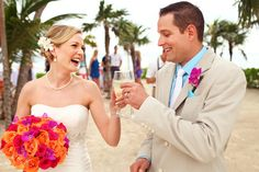 Riviera Maya Destination Wedding Barcelo Maya Colonial, a toast between newlyweds! LOVE the bright flowers in the bouquet!  Mexico wedding photographers Del Sol Photography