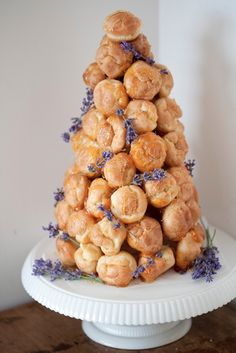 Croquembouche cake accented with sprigs of lavender {Photo by Papery and Cakery}