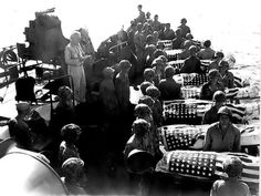 A burial at sea for US Marines who were killed during the assault of Saipan.