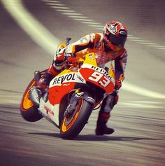 Slowing from 220mph+...you've gotta love the exuberance of youth...and carbon fibre brake discs...Marc Marquez