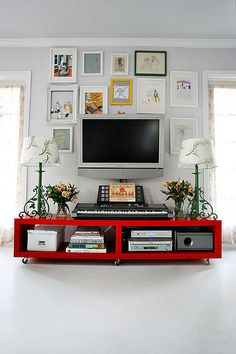 Decorate around your TV with art, photos and picture frames to create a gallery wall. #walldecor