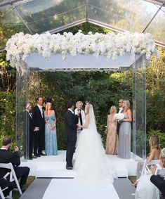 Modern Chuppah with Roses & Hydrangeas | Photography: Ira Lippke Studios. Read More:  http://www.insideweddings.com/weddings/contemporary-backyard-white-wedding-under-clear-tent-in-chicago/857/