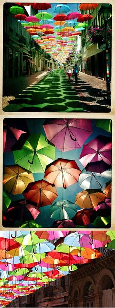 Hundreds of umbrellas float above the streets of Agueda, Portugal for the Agitagueda art festival. (Floating Umbrellas by Sexta Feira)