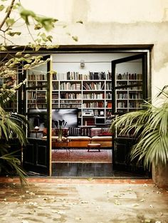 Photo (via Bloglovin.com ).  Black doors and bookshelves.