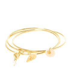 <P>Add a touch of the beach to your wrist with this pretty bangle set. Features seashell charms and one gold seashell with a crystal accent.</P><UL><LI>Gold tone finish <LI>Set of 3 <LI>Bangle bracelet</LI></UL>