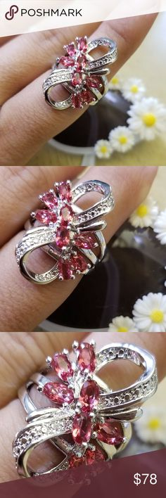 18k Swarovski flower 8 ring Brand new, never used. 18k white gold plated pink stones, with Swarovski crystal elements.... please read pic 7 & 8 for more details on what Swarovski elements are... come with a nice box Swarovski Jewelry Rings