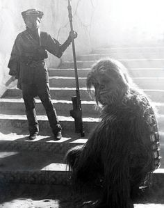 Carrie Fisher and Peter Mayhew in full Boushh and Chewbacca costume awaiting filming on Jabba's Palace set in Elstree Studios London.