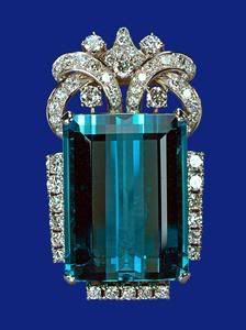 Aqua solitaire pin: Brazilian Aquamarine Necklace , earrings, bracelet and brooch were a coronation gift to Elizabeth II from the President and people of Brazil in 1953