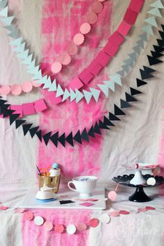 DIY No-Sew Garlands for a Birthday Party! (The backdrop is a painted drop cloth!)