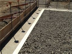View of the crushed gravel base layer (containing radon piping), prior to…