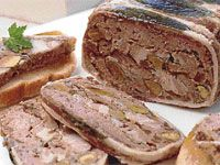 A terrine can be described as an upmarket meat loaf, usually sliced and eaten cold with pickles, potato salad, and a colourful salad alongside.