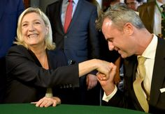 Marine Le Pen is kissed on the hand by Norbert Hofer of the Austrian Freedom...