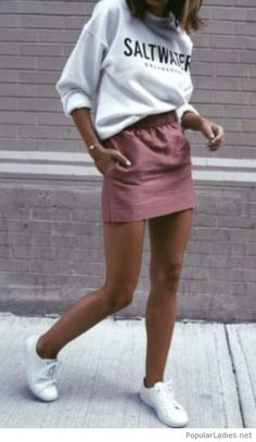 Mini skirt with a sport blouse and shoes