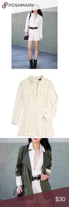"""NWT Topshop Lace-Up Long Sleeve Romper A retro-look romper in a fresh cream-colored palette is tailored with a lace-up spread-collar placket, chest pockets and long sleeves with single-button cuffs. 32 1/2"""" length; 3 1/2"""" inseam; 26"""" leg opening (size 8). Back zip closure. Lace-up neckline; spread collar. Long sleeves with single-button barrel cuffs. Chest flap pockets. 100% viscose. Machine wash warm, dry flat. By Topshop; imported. Topshop Dresses Mini"""