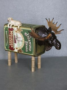 One of a kind moose sculpture with porcelain head, molasses tin, wood spools, porcelain dog, and found objects for tail. Recycled Robot, Recycled Art, Found Object Art, Found Art, Tin Can Animals, Robot Animal, Wood Spool, Tin Man, Assemblage Art