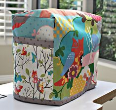 Sewing machine cover instructions to fit any machine at Strawberry Patches blog http://patches.typepad.com/notes_from_the_patch/2010/11/tutorial-tuesday-32-sewing-machine-cozy.html