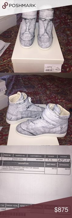 Mens maison margiela sneaker size 12 Mens maison margiela sneaker crackled leather very RARE only sold exclusively at Barneys New York !!! Size 12 euro 45. Have worn twice. The shoes are a 9/10. As you wear them it gives the shoe a patina look. Brilliant. Maison Margiela Shoes Sneakers