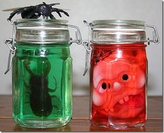 Halloween Idea    These specimen jars literally took 2 minutes to make.   What you need:  jars  water  food color  bugs or body parts  How to make:  Fill the jar about 3/4 with water.    Add a couple of drops of food  color  Pop in your 'specimen'  Done!