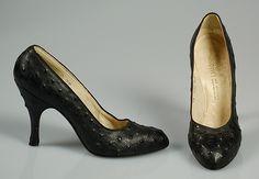 Designer: Mr. David Evins (American, born England, 1909–1992) Department Store: I. Magnin & Co. (American, founded 1876) Date: ca. 1957 Culture: American Medium: Leather
