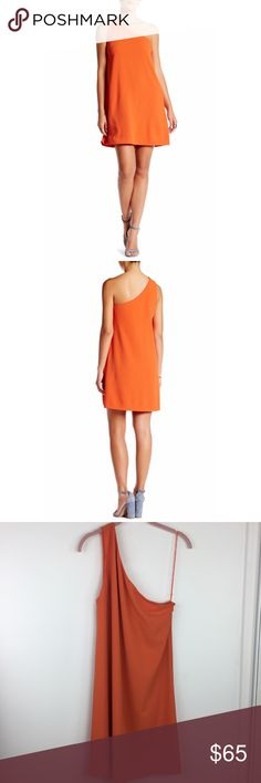 """Alice + Olivia Electra One Shoulder Flare Dress Alice + Olivia Orange Electra One Shoulder Flare Dress.  Approx 17.5"""" armpit to armpit and 37"""" length.  100% Polyester.  Fully lined.  NWT.  Small makeup mark along Neckline. Alice + Olivia Dresses One Shoulder"""