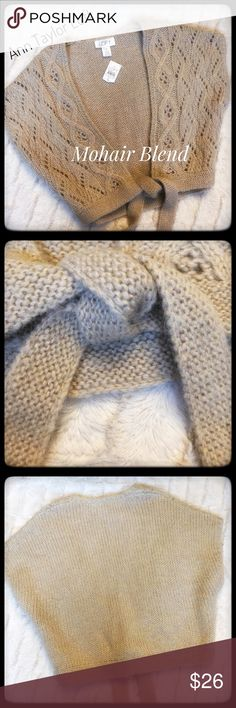 NWT Ann Taylor Loft Mohair Blend Sweater Shrug Beautiful shrug by Ann Taylor LOFT! The mohair blend is super soft and has that cozy fur feel. It is a very neutral tan to Taupe color and the sassy sash really adds to the Designer Appeal. Excellent condition as it is NWT. Enjoy! LOFT Tops