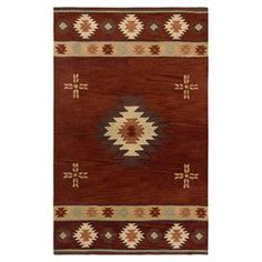 Wool rug with a Southwestern-inspired motif. Hand-tufted in India.  Product: RugConstruction Material: 100% WoolColor: RedFeatures:  Hand-TuftedMade In IndiaInspired by the distinctive styling of Native American art and textiles  Note: Please be aware that actual colors may vary from those shown on your screen. Accent rugs may also not show the entire pattern that the corresponding area rugs have.Cleaning and Care: Vacuum regularly and spot clean