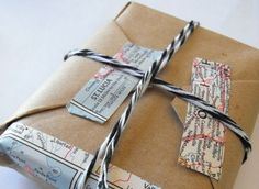 Map + Double-sided tape + butcher paper as gift wrap = Cool! (esp. for a travel-themed gift)