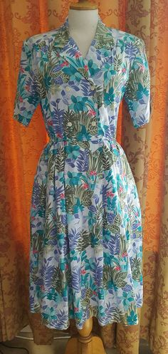 Check out this item in my Etsy shop https://www.etsy.com/uk/listing/278454712/1980s-does-1950s-vintage-dress-swing