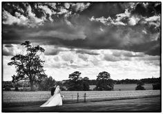 Blake Hall wedding photography with the bride and groom walking through the grounds. Blake Hall wedding photography http://www.weddingphotojournalist.co.uk/lauren-and-matts-wedding-at-blake-hall/