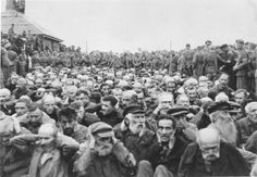 Zhitomir, Ukraine, German soldiers surrounding Jews in the market square, 07/08/1941. They will be sadly marched to a ditch and shot in the head and buried in mass.