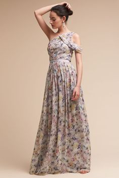 Nothing says spring more than a floral bridesmaid dress. Shop 12 floral bridesmaid dresses for a spring or summer wedding Bridesmaid Dresses Floral Print, Affordable Bridesmaid Dresses, Navy Floral Dress, Long Bridesmaid Dresses, Wedding Dresses, Bridesmaids, Peach Dresses, Party Dresses, Draped Dress
