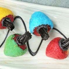 Christmas Light Strawberries | MyRecipes   Create an edible string of multi-colored Christmas lights with this unique idea for chocolate-covered strawberries.