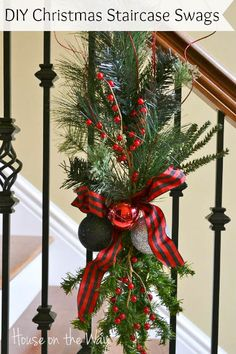 Christmas Staircase Swags from houseontheway.com. This Christmas Staircase Decorating Idea is a great alternative to the traditional Christmas garland. Using swags give a stunning look that is so different than typical garland.
