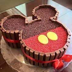 black, cake, chocolate, delicious, dessert, fancy, food, kitkat, mickey mouse, red, ribbon, sprinkles, yellow