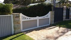 Sandstone pillars with a wooden fence Front Yard Fence, Front Gates, Entrance Gates, Front Yard Landscaping, Mailbox Installation, Brick Mailbox, Hot Tub Patio, Trellis Fence, Concrete Walkway