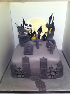Nightmare Before Christmas cake created by Tyra Burgess. This graveyard cake has a cardboard box surround for a spooky background to hang from.