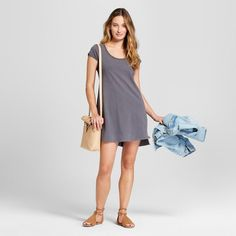 As trusty as your favorite go-to T-shirt, you'll love to slip on the Short-Sleeve Knit Shirtdress from Universal Thread™. With a scoop neck and notches on the hem, this short-sleeve T-shirt dress lends itself as the perfect starting point for a personalized look you change up again and again. Wear with a distressed denim jacket and lace-up sandals for summer barbecues and bonfires, then layer on a denim shirt tied at the waist, sweater tights and booties when cooler temperatures ...