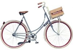 The styling of this bike and the Roetz line of accessories is really nice--their crates and bags are recycled. The soft grey and white of the bike with the light-colored wooden fenders and crate is clean and classic. The white tires and red rims give it some panache.