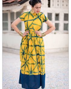 Yellow tie and dye dress with high neckline and is perfect for any occasion