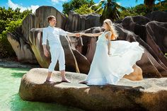 Anse Source D'Argent, La Digue wedding couple Maxim & Vasilisa,  destination wedding photography: mukhina.com  I took this photo in April, 2011 at Coco de Mer hotel, at the wedding of Maxim & Vasilisa  Praslin, Seychelles - wedding photography Mukhin Situated in the heart of Chicago's Jewelers Row, Ethan Lord specializes in custom bridal jewelry like engagement rings and wedding bands. - http://www.ethanlord.com/