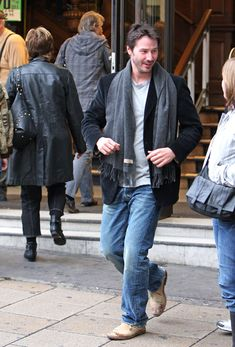 """Keanu Reeves Photos Photos - Actor Keanu Reeves looks at his map and asks for directions to find his way to the """"Geo F Trumper - London's Favorite barber and perfumer since 1875.""""  Once there the actor buys $107.32 dollars (£ 68 pounds) worth of specialty shaving cream . - Keanu Reeves Goes to the Barber"""