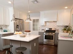 To make the space feel larger, Joanna painted the upper cabinets white and the lower cabinets and island gray. Stainless steel appliances and polished metal lighting were installed giving the kitchen a professional, gourmet look.