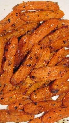 Honey Roasted Carrots ~ 3 cups of Baby Carrots or Carrots cut into french fry like spears, 1 tbsp Honey, 1 tbsp. Olive Oil, Sea Salt, fresh Ground Pepper Cooking Spray