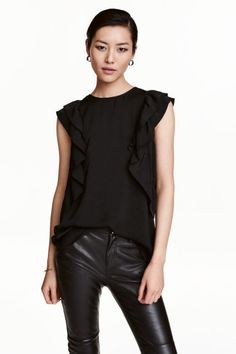 Frilled top: Straight-cut, sleeveless top in a slightly crinkled weave with a double frill on the shoulders and at the sides, and an opening with a button at the back of the neck.