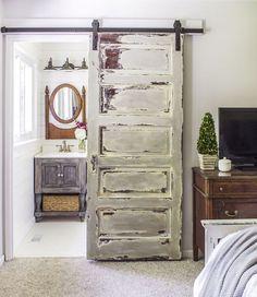 Replace a conventional, swinging door with an upcycled, sliding barn door. Bathroom Barn Door, Diy Barn Door, Bathroom Cabinets, Bathroom Sinks, White Bathroom, Bathroom Shelves, Basement Bathroom, Rustic Barn Doors, Warm Bathroom