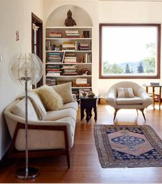 """""""Undecorate"""" -> fantastic couch, chair, floor lamp, built-in with Buddha, rug, and Moroccan side table. Not to mention the wonderful window."""
