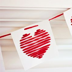 String up some love this Valentine's Day with this easy paper and yarn heart garland!