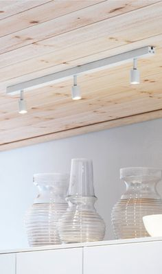 BÄVE LED ceiling track with 3 spots above a wall cabinet