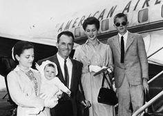"13 Jun 1954, New York, New York, USA --- 6/13/1954-New York, NY-Theatrical and movie star Henry Fonda is surrounded by his family, as he and they prepare to board an American Airlines plane for a brief vacation in Los Angeles. Later, they are scheduled to proceed to Honolulu, where Fonda will start work on the movie version of ""Mr. Roberts."" Pictured (L-R) areMrs. Fonda, holding baby daughter Amy; Henry; daughter Jane; and son Peter."